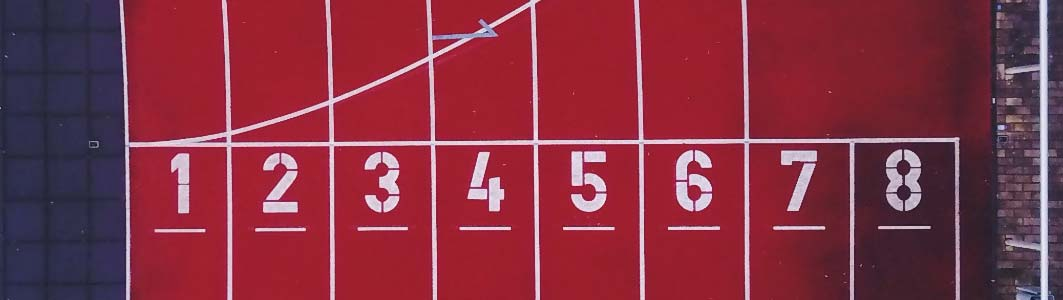 Translation Prices - Image of the starting blocks on a race track.